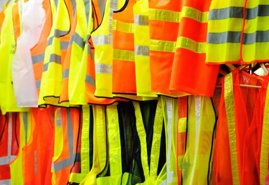 Lots of hi visibility vests hanging up