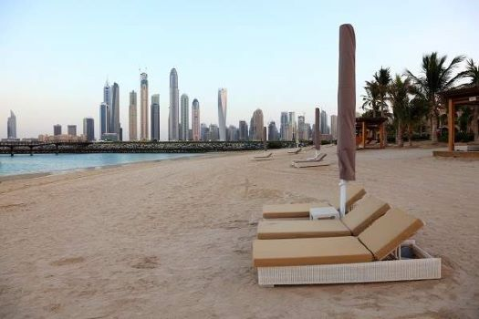 Beach in Dubai with view of skyline