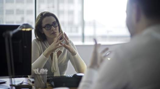 Woman in office with client